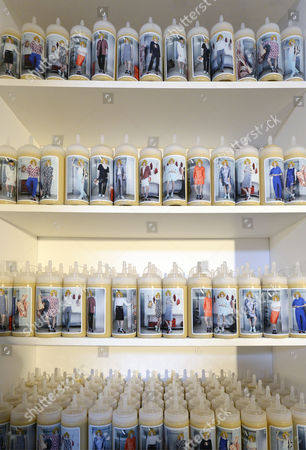 A General View of Bottles with Labels Showing the Creations of the Collection From the Spring/summer 2015 Ready to Wear Collection by Belgian Fashion Designer Jean-paul Lespagnard Presented During the Paris Fashion Week in Paris France 28 September 2014 the Presentation of the Women's Collections Runs From 23 September to 01 October France Paris