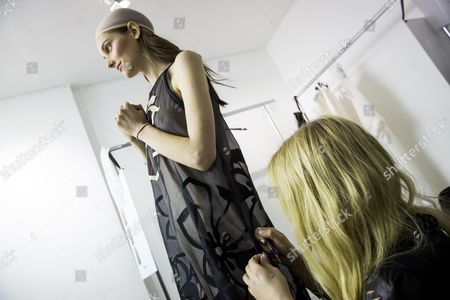 A Model is Being Dressed Backstage Prior to the Presentation of the Spring/summer 2015 Ready to Wear Collection by German Designers Johanna Kuehl and Alexandra Fischer-roehler For Their Label Kaviar Gauche During the Paris Fashion Week in Paris France 24 September 2014 the Presentation of the Women's Collections Runs From 23 September to 01 October France Paris