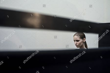 Stock Photo of A Model Waits Inside the Backstage Prior to the Presentation of the Spring/summer 2015 Ready to Wear Collection by French Designer Marcel Marongiu For Guy Laroche Fashion House During the Paris Fashion Week in Paris France 24 September 2014 the Presentation of the Women's Collections Runs From 23 September to 01 October France Paris