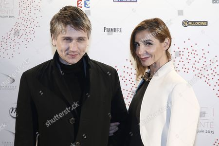 French Actress Clotilde Courau (r) and French Actor Stanislas Merhar Pose For the Photographers During a Photocall Organized Prior to the Vip Opening of the Exhibition 'Lumiere ! Le Cinema Invente' (lumiere ! the Cinema Invented) at the Grand Palais in Paris France 26 March 2015 For the 120th Anniversary of the Invention of the Cinematograph the Lumiere Institute Organizes an Exhibition 'Lumiere ! Le Cinema Invente' (lumiere ! the Cinema Invented) Which Retraces the Inventions of the Two French Brothers Louis Et Auguste Lumiere the Event Runs From 27 March to 14 June 2015 France Paris