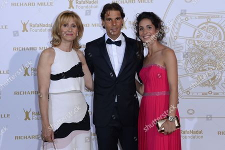 Spanish Tennis Player Rafael Nadal (c) His Mother Ana Maria Parera (l) and His Girlfriend Maria Francisca Perello (r) Pose For the Photographers During a Photocall For the Gala For the Rafa Nadal Foundation in Paris France 23 May 2015 Created in 2007 the Foundation Aims to Help Socially Discriminated Children and Teenagers Through Educational Programs with Sport As a Common Denominator France Paris