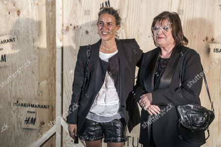Head of the Design For H&m Margareta Van Den Bosch (r) and French Fashion Designer Isabel Marant (l) Pose For the Photographers During the Photocall of 'Isabel Marant For H&m' at the Tennis Club De Paris in Paris France 24 October 2013 France Paris