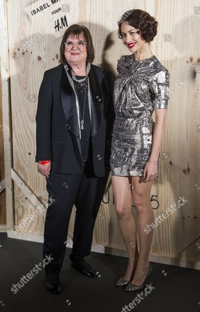 Stock Image of Head of the Design For H&m Margareta Van Den Bosch (l) and French Model and Actress Olga Kurylenko Pose For the Photographers During the Photocall of 'Isabel Marant For H&m' at the Tennis Club De Paris in Paris France 24 October 2013 France Paris