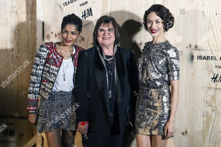Stock Photo of Indian Actress Freida Pinto Head of the Design For H&m Margareta Van Den Bosch ? and French Actress and Model Olga Kurylenko (r) Pose For the Photographers During the Photocall of 'Isabel Marant For H&m' at the Tennis Club De Paris in Paris France 24 October 2013 France Paris