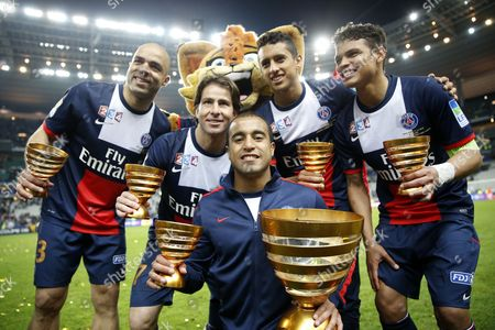 Stock Picture of Paris Saint Germain's Brazilian Players (l-r) Alex Maxwell Lucas Moura Marquinhos and Thiago Silva Celebrate with the Trophy After Their Victory Against Olympique Lyon During the French League Cup Final at the Stade De France Stadium in Saint Denis Near Paris France 19 April 2014 France Saint Denis