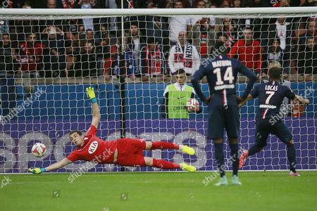 Bordeaux Goalkeeper Cedric Carrasso Tries to Block a Penalty Shot by Psg Midfielders Lucas During the French Ligue 1 Soccer Match Between Psg and Bordeaux at the Parc Des Princes Stadium in Paris France 25 October 2014 France Paris