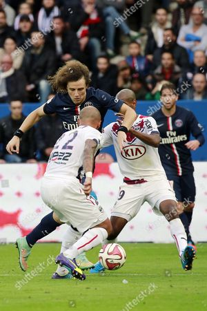 Psg Defense Player David Luiz Vies For the Ball Against Bordeaux Defense Player Julien Faubert and His Teammate Diego Rolan During the French Ligue 1 Soccer Match Between Psg and Bordeaux at the Parc Des Princes Stadium in Paris France 25 October 2014 France Paris