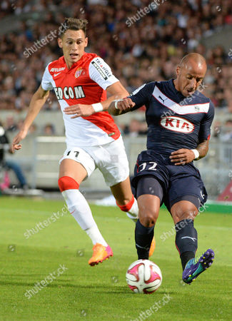 Julien Faubert (r) of Bordeaux Vies For the Ball with Lucas Ocampos (l) of Monaco During Their Ligue 1 Soccer Match Between Girondins Bordeaux and Monaco at the Chaban Delmas Stadium in Bordeaux France 17 August 2014 France Bordeaux