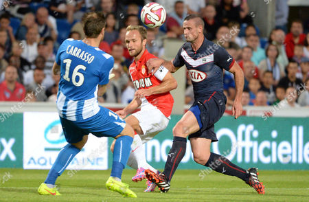 Nicolas Pallois (r) of Bordeaux Vies For the Ball with Cedric Carrasso (l) of Bordeaux and Valere Germain (c) of Monaco During Their Ligue 1 Soccer Match Between Girondins Bordeaux and Monaco at the Chaban Delmas Stadium in Bordeaux France 17 August 2014 France Bordeaux