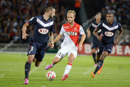 Germain Valere (c) of Monaco Vies For the Ball with Diego Contento (l) and Nicolas Maurice-belay (r) of Bordeaux During Their Ligue 1 Soccer Match Between Girondins Bordeaux and Monaco at the Chaban Delmas Stadium in Bordeaux France 17 August 2014 France Bordeaux