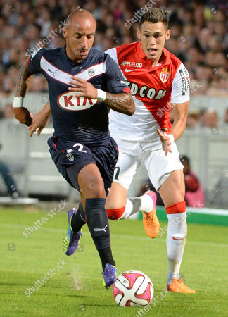 Julien Faubert (l) of Bordeaux Vies For the Ball with Lucas Ocampos (r) of Monaco During Their Ligue 1 Soccer Match Between Girondins Bordeaux and Monaco at the Chaban Delmas Stadium in Bordeaux France 17 August 2014 France Bordeaux