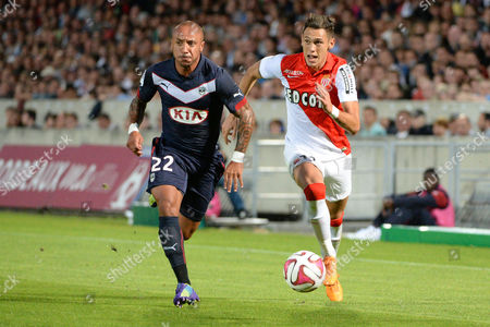 Stock Image of Julien Faubert (l) of Bordeaux Vies For the Ball with Lucas Ocampos (r) of Monaco During Their Ligue 1 Soccer Match Between Girondins Bordeaux and Monaco at the Chaban Delmas Stadium in Bordeaux France 17 August 2014 France Bordeaux
