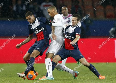 Stock Photo of Moura Da Silva Lucas (r) and Yohan Cabaye (l) of Paris Saint Germain Vies For the Ball with Julien Faubert (c) of Bordeaux During the French Ligue 1 Soccer Match Between Psg and Bordeaux at the Parc Des Princes Stadium in Paris France 31 January 2014 France Paris