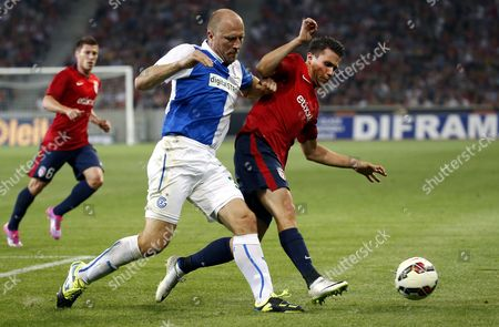 Grasshopper Zurich Stephane Grichting (l) in Action Against Lille Osc Player Jonathan Delaplace (r) During the Uefa Champions League Third Qualifying Round Soccer Match Between Lille Osc and Grasshopper Club Zurich in Lille France 05 August 2014 France Lille