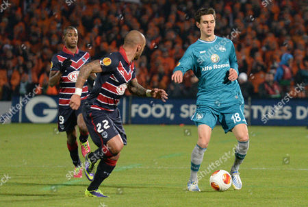 Johannes Flum (r) of Eintracht Frankfurt Vies For the Ball with Julien Faubert (c) and Diego Rolan (l) of Bordeaux During Their During Their Uefa Europa League Match Between Girondins Bordeaux and Eintracht Frankfurt in Bordeaux France 28 November 2013 France Bordeaux