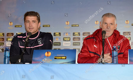 Girondins Bordeaux Goalkeeper Cedric Carrasso (l) and Girondins Bordeaux Coach Francis Gillot (r) Speak to Journalists During Their Press Conference After Their Training Session at Jacques Chaban Delmas Stadium at the Eve of the Uefa Europa League Group F Football Match Against Eintracht Frankfurt in Bordeaux France 27 November 2013 France Bordeaux