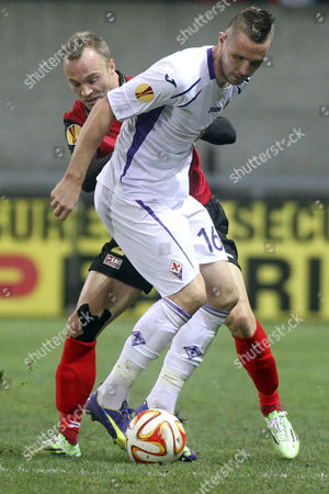 Lars Jacobsen (rear) of Ea Guingamp in Action Against Jasmin Kurtic (front) of Acf Fiorentina During the Uefa Europa League Soccer Match Between Ea Guingamp and Acf Fiorentina at Roudourou Stadium in Guingamp France 27 November 2014 France Guingamp