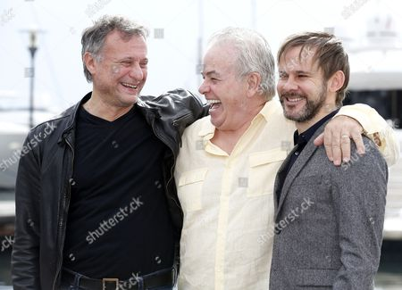 Stock Photo of (l-r) Swedish Actor Michael Nyqvist Us Screenwriter Bobby Moresco and British Actor Dominic Monaghan Pose During a Photocall For the Tv Series '100 Code' at the Annual Mipcom Television Content Market in Cannes France 13 October 2014 the Media Event Runs From 13 to 16 October France Cannes