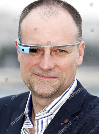 Canadian Actor David Hewlett Poses with Google Glass During a Photocall For the Tv Series 'State of Syn' at the International Audiovisual and Digital Content Market Miptv 2014 Held at the Festival Palace in Cannes France 08 April 2014 the Miptv Which Runs From 07 to 10 April is One of the World's Leading International Trade Events Dedicated to International Television Programs and to Digital Content and Interactive Entertainment For All Platforms France Cannes