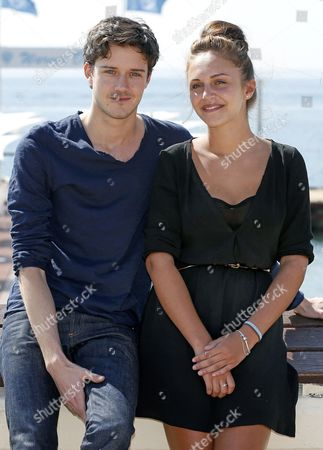 Stock Image of French Actor Cesar Domboy (l) and Belgium Actress Pauline Burlet (r) Pose During a Photocall For the Tv Series 'Resistance' at the International Audiovisual and Digital Content Market Miptv 2014 Held at the Festival Palace in Cannes France 07 April 2014 the Miptv Which Runs From 07 to 10 April is One of the World's Leading International Trade Events Dedicated to International Television Programs and to Digital Content and Interactive Entertainment For All Platforms France Cannes