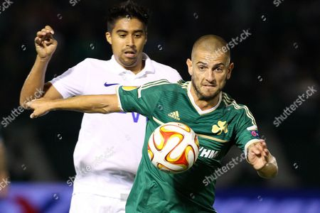 Mladen Petric (f) of Panathinaikos Athens and Christian Noboa (b) of Dinamo Moscow in Action During the Uefa Europa League Group E Soccer Match Between Panathinaikos Athens and Dinamo Moskva at Apostolos Nikolaidis Stadium in Athens Greece 18 September 2014 Greece Athens
