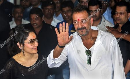 Bollywood Actor Sanjay Dutt (r) and Wife Manyata Dutt Wave to His Fans Before a Press Conference at His Residence in Mumbai India 25 February 2016 Sanjay Dutt was Released From Prison After Serving Time For His Role in the 1993 Mumbai Bombings the 56-year-old Actor was Sentenced to Five Years in 2013 For Illegally Possessing Weapons That Were Part of an Arms Consignment Meant For Use in the Attacks Which Claimed 257 Lives India Mumbai