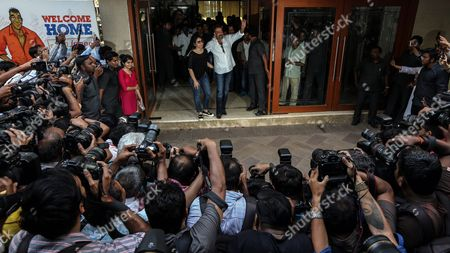 Bollywood Actor Sanjay Dutt (c-r) and Wife Manyata Dutt Wave to His Fans Before a Press Conference at His Residence in Mumbai India 25 February 2016 Sanjay Dutt was Released From Prison After Serving Time For His Role in the 1993 Mumbai Bombings the 56-year-old Actor was Sentenced to Five Years in 2013 For Illegally Possessing Weapons That Were Part of an Arms Consignment Meant For Use in the Attacks Which Claimed 257 Lives India Mumbai