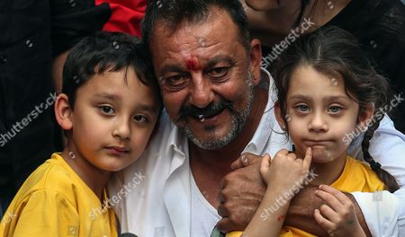 Bollywood Actor Sanjay Dutt with His Twin Children Shahraan (l) and Iqra (r) Smiles a Press Conference at His Residence in Mumbai India 25 February 2016 Sanjay Dutt was Released From Prison After Serving Time For His Role in the 1993 Mumbai Bombings the 56-year-old Actor was Sentenced to Five Years in 2013 For Illegally Possessing Weapons That Were Part of an Arms Consignment Meant For Use in the Attacks Which Claimed 257 Lives India Mumbai