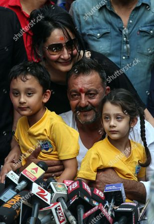 Bollywood Actor Sanjay Dutt (c) Wife Manyata (top) and Their Twin Children Shahraan (l) and Iqra (r) Smile a Press Conference at His Residence in Mumbai India 25 February 2016 Sanjay Dutt was Released From Prison After Serving Time For His Role in the 1993 Mumbai Bombings the 56-year-old Actor was Sentenced to Five Years in 2013 For Illegally Possessing Weapons That Were Part of an Arms Consignment Meant For Use in the Attacks Which Claimed 257 Lives India Mumbai