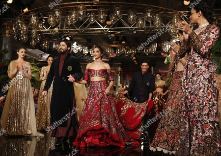 Indian Bollywood Actor Fawad Khan (c-l) and Actress Deepika Padukone (c-r) and Other Models Present a Creation by Indian Designer Manish Malhotra During the Fdci India Couture Week 2016 in New Delhi India 20 July 2016 the Fashion Event is Scheduled From 20 to 24 July India New Delhi