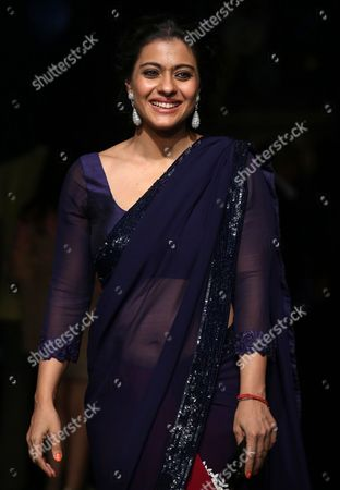 Bollywood Actress Kajol Devgan Poses For Photographs As She Arrives at the Lakme Fashion Week Grand Finale by Indian Designer Manish Malhotra in Mumbai India 24 August 2014 the Presentations of the Winter/festive 2014 Collections Are Held From 20 to 24 August India Mumbai