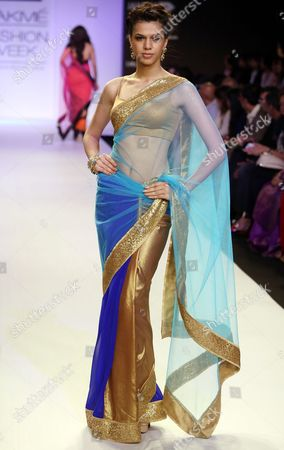 Stock Picture of A Model Presents a Creation by Indian Designer Mandira Bedi During the Lakme Fashion Week Summer/resort 2014 in Mumbai India 13 March 2014 Some 92 Designers Will Be Showcasing Their Collections During the Event Running From 12 to 16 March India Mumbai