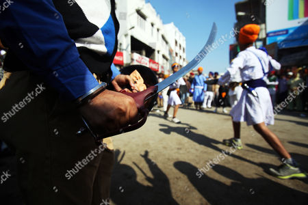A Sikh Man Holds His Sword As He Waits For His Turn to Perform Gatka a Form of Sikh Martial Arts During a Religious Procession to Celebrate the Birth Anniversary of the First Sikh Guru Or Master Sri Guru Nanak Dev Ji the Founder of Sikhism in Amritsar India 16 November 2013 the Birth Anniversary of Guru Nanak Dev Ji Will Be Observed on 17 November India Amritsar
