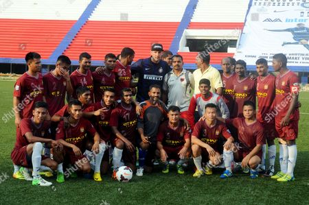 Former Inter Milan Player Marco Materazzi (c) Poses For a Photograph with Players of the Meg Team at Bangalore Stadium India 23 May 2014 Inter Milan is to Launch a Youth Academy in Hosur on the Outskirts of Bangalore by 01 June 2014 India Bangalore