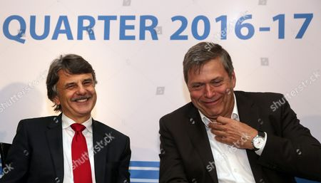 Ralf Speth (l) Global Chief Executive Officer Jaguar Land Rover and Guenter Butschek (r) Chief Executive Officer Tata Motors Reacts During a Press Conference to Announce Tata Motor's First Quarter Financial Resultsfor 2016-17 in Mumbai India 26 August 2016 India Mumbai