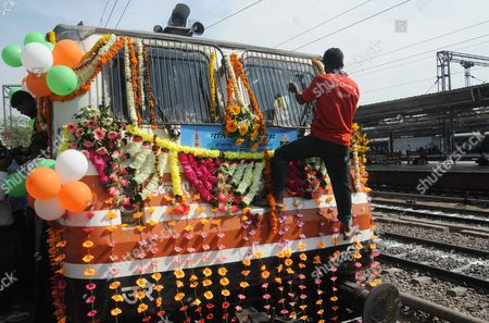 A Man Places a Flower Garlands on the Front of the Gatimaan Express India's First Semi-high Speed Train at the Nizamuddin Railway Station in Delhi India 05 April 2016 the Gatimaan Express was Flagged Off by Indian Railways Rail Minister Suresh Prabhu and Will Run Between Delhi to Agra with a Top Speed of 160 Kph India New Delhi
