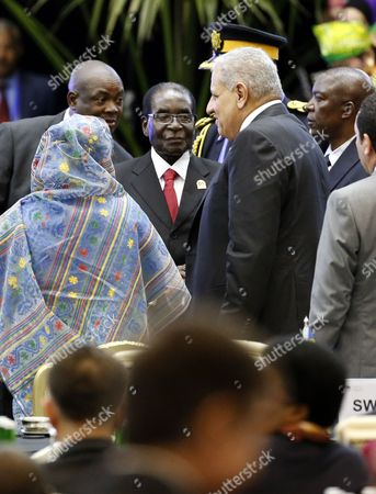 Zimbabwean President Robert Mugabe (c-l) Greets Egypt's Prime Minister Ibrahim Mahlab (c-r) During the Opening Ceremony of the Asian African Conference in Jakarta Indonesia 22 April 2015 the 60th Asian-african Conference is Held in Jakarta and Bandung From 19 to 24 April 2015 Indonesia Jakarta