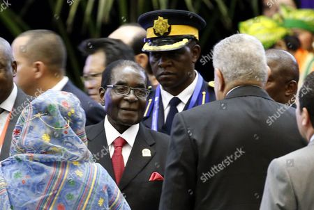 Zimbabwean President Robert Mugabe (c) Greets Egypt's Prime Minister Ibrahim Mahlab (r) During the Opening Ceremony of the Asian African Conference in Jakarta Indonesia 22 April 2015 the 60th Asian-african Conference is Held in Jakarta and Bandung From 19 to 24 April 2015 Indonesia Jakarta