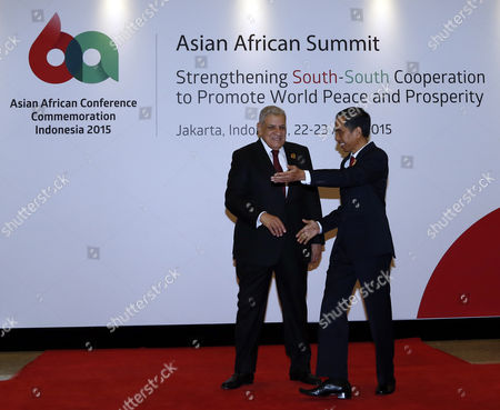 Indonesian President Joko Widodo (r) Greets Egypt's Prime Minister Ibrahim Mahlab During the Arrival For the Opening Ceremony of the Asian African Conference in Jakarta Indonesia 22 April 2015 the 60th Asian-african Conference is Held in Jakarta and Bandung From 19 to 24 April 2015 Indonesia Jakarta