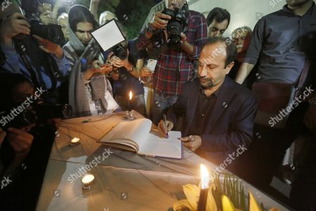 Iranian Film Director Asghar Farhadi (r) Signs a Memorial Book During a Candlelight Ceremony Mourning the Death of Late Iranian Film Director Abbas Kiarostami at the Cinema Museum in Tehran Iran 05 July 2016 According to Media Reports Award-winning Film Director Abbas Kiarostami Died After Several Months of Illness at the Age of 76 in Paris France on 04 July 2016 the Director Suffered Since the End of March of Gastrointestinal Cancer and Had Been Undergoing Hospital Treatment in France Media Added Kiarostami Whose Career Spanned 40 Decades was Considered One of the Most Prominent Directors of Iran Iran (islamic Republic Of) Tehran