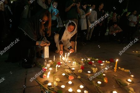 Iranians Light Candles As Some Hundred People Attend a Candlelight Ceremony Mourning the Death of Late Iranian Film Director Abbas Kiarostami at the Cinema Museum in Tehran Iran 05 July 2016 According to Media Reports Award-winning Film Director Abbas Kiarostami Died After Several Months of Illness at the Age of 76 in Paris France on 04 July 2016 the Director Suffered Since the End of March of Gastrointestinal Cancer and Had Been Undergoing Hospital Treatment in France Media Added Kiarostami Whose Career Spanned 40 Decades was Considered One of the Most Prominent Directors of Iran Iran (islamic Republic Of) Tehran