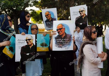 Iranians Hold Posters Depicting Iranian Film Director Abbas Kiarostami During a Funeral Ceremony at the Center For the Intellectual Development of Children and Young Adults in Tehran Iran 10 July 2016 According to Media Reports Award-winning Filmmaker Kiarostami Died After Several Months of Illness at the Age of 76 in Paris France on 04 July 2016 He Had Been Suffering From Gastrointestinal Cancer Since the End of March and Had Been Undergoing Hospital Treatment in France Kiarostami Whose Career Spanned 40 Decades was Considered One of the Most Prominent Directors of Iran Iran (islamic Republic Of) Tehran