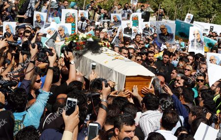Stock Picture of Iranians Carry the Coffin of Iranian Film Director Abbas Kiarostami During a Funeral Ceremony in Tehran Iran 10 July 2016 According to Media Reports Award-winning Filmmaker Kiarostami Died After Several Months of Illness at the Age of 76 in Paris France on 04 July 2016 He Had Been Suffering From Gastrointestinal Cancer Since the End of March and Had Been Undergoing Hospital Treatment in France Kiarostami Whose Career Spanned 40 Decades was Considered One of the Most Prominent Directors of Iran Iran (islamic Republic Of) Tehran