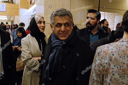 Iranian Director Mani Haghighi (c) Arrives Before the Screening of His Movie 'A Dragoon Arrives!' During the 34th Fajr Film Festival at the Milad Tower Hall in Tehran Iran 08 February 2016 the Festival Runs Until 10 February His Movie Also Will Compete at Berlin Film Festival Iran (islamic Republic Of) Tehran