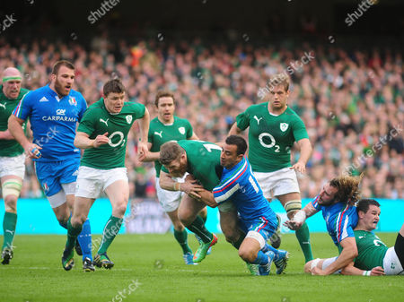 Ireland's Gordon D'arcy (c) is Tackled by Italy's Luciano Orquera During the Rbs Rugby Six Nations Match Between Ireland and Italy at the Aviva Stadium in Dublin Ireland 08 March 2014 Ireland Dublin