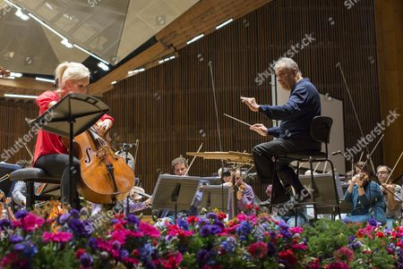 Indian Conductor Zubin Mehta (r) Performs with Canadian Cellist Amanda Forsyth (l) During a Dress Rehearsal with the Israel Philharmonic Orchestra (ipo) at the Habima Theater in Tel Aviv Israel 13 April 2016 on Occasion of His 80th Birthday on 29 April Mehta was Born the Same Year As the Israel Philharmonic Orchestra and For the Last Five Decades He and the Ipo Have Worked Hand-in-hand to Promote Classical Music in Israel and Around the World Israel Tel Aviv