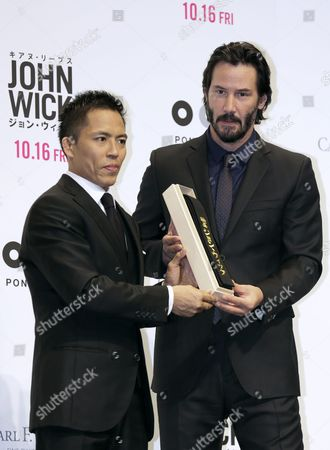Canadian Actor/cast Member Keanu Reeves (r) Poses Next to Three-time Olympic Judo Champion in Men's 66 Kg Category Tadahiro Nomura (l) As He Receives a Judo's Kuro-obi Or Black Belt by Nomura During the Premiere of 'John Wick' Directed by Chad Stahelski and David Leitch in Tokyo Japan 30 September 2015 the Movie Will Be Released in Japan Theaters on 16 October 2015 Japan Tokyo