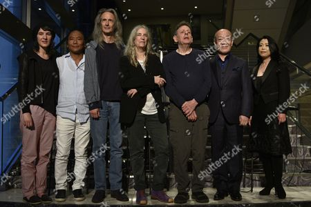 (l-r) Patti Smith's Daughter Jesse Smith Tibetan Singer Tenzin Choegyal Us Musician Lenny Kaye Us Singer Patti Smith Us Composer Philip Glass Japanese Composer Joe Hisaishi and Pianist Maki Namekawa Pose During a Press Conference For 'The Poet Speaks' and 'The Complete Etudes' at the Sumida Triphony Hall in Tokyo Japan 03 June 2016 'The Poet Speaks' and 'The Complete Etudes' Will Be Played on 04 and 05 June Japan Tokyo