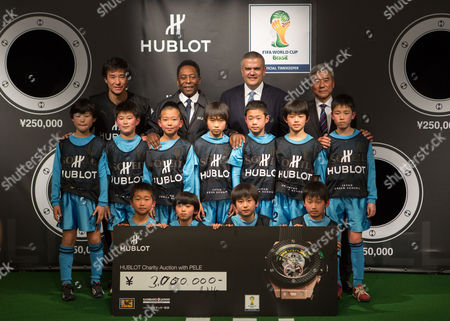 Attendees of the Hublot Charity Event Held at the Japan Football Association Headquarters in Tokyo Japan 13 March 2014 the Event Raised 3 Million Yen (approximately 29 000 Us Dollars) in Which the Proceeds Will Be Donated to Help the Victims of the 2011 Japan March 11 Earthquake and Tsunami Front and Middle Rows: Japanese Soccer Kids Back Row (l-r): Retired Japanese Professional Soccer Player Masashi Nakayama Hublot Brand Ambassador Pele (edson Arantes Do Nascimento) Ceo of Hublot Ricardo Guadalupe and Japan Football Association President Kuniya Daini Japan Tokyo