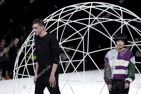 Designers Steven Hall (l) and Yurika Ohara Acknowledge the Audience After the Fashion Show For Their Label In-process by Hall Ohara During the Mercedes-benz Fashion Week in Tokyo Japan 17 March 2016 the Presentation of the Autumn/winter 2016 Collections Runs From 14 to 19 March Japan Tokyo